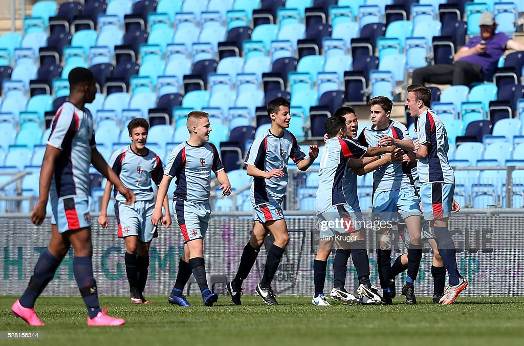 Aleksander Angelinov of King Edwards's School Witley celebrates the opening goal during the Premier League under 16 Small Schools' Cup final match between King Edwards's School Witley and Blacon High School at the Academy Training Ground on May 04, 2016 in Manchester, England.