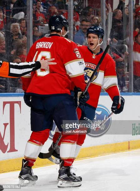 Aleksander Barkov is congratulated by Jonathan Huberdeau of the Florida Panthers after he scored a first period goal against the Toronto Maple Leafs...