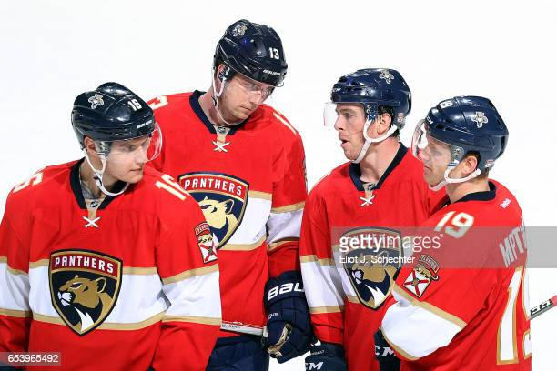 Aleksander Barkov of the Florida Panthers and teammates Mark Pysyk Jonathan Marchessault Michael Matheson chat during a break in the action against...