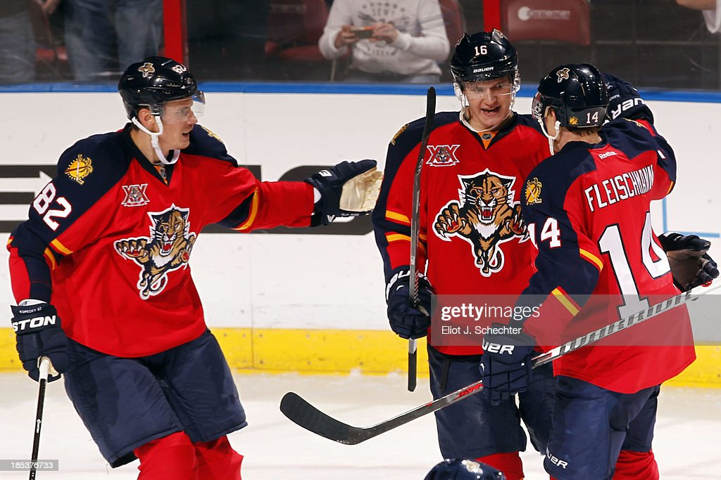 <a gi-track='captionPersonalityLinkClicked' href=/galleries/search?phrase=Aleksander+Barkov&family=editorial&specificpeople=8760147 ng-click='$event.stopPropagation()'>Aleksander Barkov</a> #16 of the Florida Panthers celebrates his goal with teammates <a gi-track='captionPersonalityLinkClicked' href=/galleries/search?phrase=Tomas+Kopecky&family=editorial&specificpeople=2234349 ng-click='$event.stopPropagation()'>Tomas Kopecky</a> #82 and <a gi-track='captionPersonalityLinkClicked' href=/galleries/search?phrase=Tomas+Fleischmann&family=editorial&specificpeople=554398 ng-click='$event.stopPropagation()'>Tomas Fleischmann</a> #14 against the Minnesota Wild at the BB&T Center on October 19, 2013 in Sunrise, Florida.