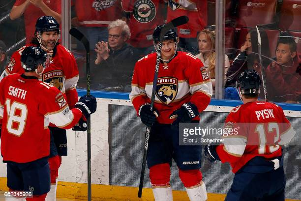 Aleksander Barkov of the Florida Panthers celebrates his goal with teammates against the Minnesota Wild at the BBT Center on March 10 2017 in Sunrise...
