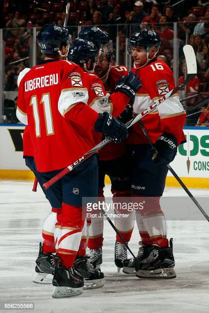 Aleksander Barkov of the Florida Panthers celebrates his goal with teammates during the first period against the Carolina Hurricanes at the BBT...