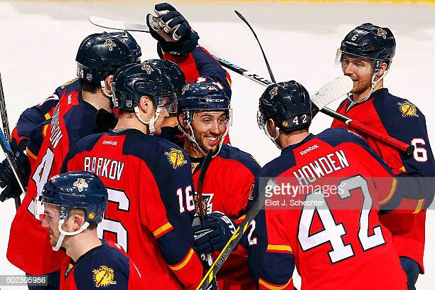 Aleksander Barkov of the Florida Panthers celebrates with teammates Vincent Trocheck and Quinton Howden his shootout goal for the win against the...
