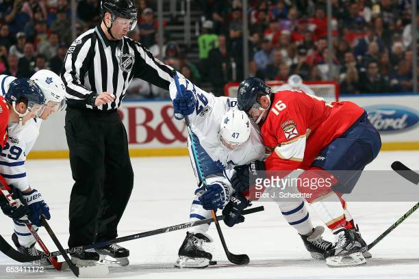 Aleksander Barkov of the Florida Panthers faces off against Leo Komarov of the Toronto Maple Leafs at the BBT Center on March 14 2017 in Sunrise...