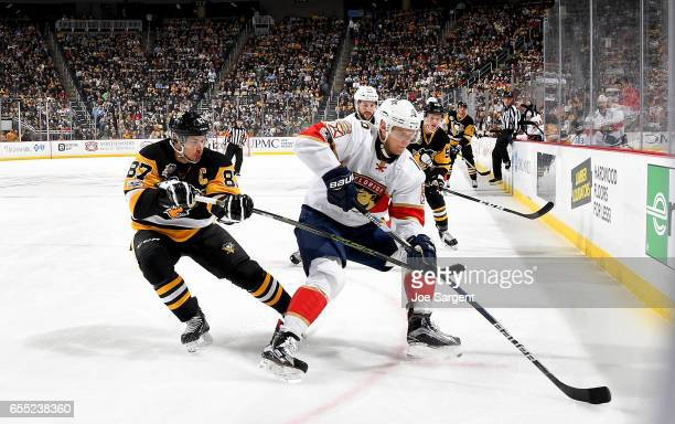 Aleksander Barkov of the Florida Panthers handles the puck against Sidney Crosby of the Pittsburgh Penguins at PPG Paints Arena on March 19 2017 in...