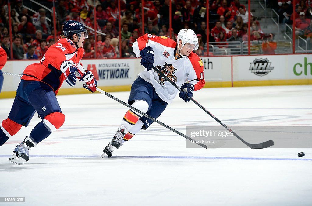 <a gi-track='captionPersonalityLinkClicked' href=/galleries/search?phrase=Aleksander+Barkov&family=editorial&specificpeople=8760147 ng-click='$event.stopPropagation()'>Aleksander Barkov</a> #16 of the Florida Panthers handles the puck in the first period against John Carlson #74 of the Washington Capitals at the Verizon Center on November 2, 2013 in Washington, DC.