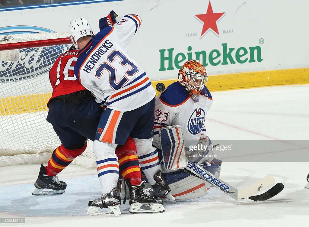 Aleksander Barkov #16 of the Florida Panthers is unable to get to the puck while being defended by Matt Hendricks #23 of the Edmonton Oilers as the puck goes past Goaltender Cam Talbot #33 at the BB&T Center on January 18, 2016 in Sunrise, Florida. The Oilers defeated the Panthers 4-2.