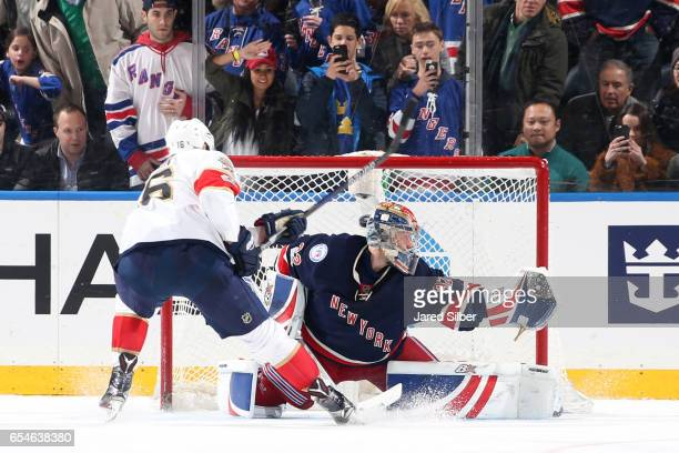 Aleksander Barkov of the Florida Panthers lifts the puck past Antti Raanta of the New York Rangers for the game winning goal in the shootout at...