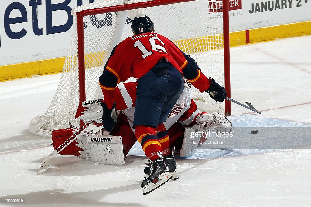 <a gi-track='captionPersonalityLinkClicked' href=/galleries/search?phrase=Aleksander+Barkov&family=editorial&specificpeople=8760147 ng-click='$event.stopPropagation()'>Aleksander Barkov</a> #16 of the Florida Panthers scores a goal in the shootout against Goaltender <a gi-track='captionPersonalityLinkClicked' href=/galleries/search?phrase=Jimmy+Howard&family=editorial&specificpeople=2118637 ng-click='$event.stopPropagation()'>Jimmy Howard</a> #35 of the Detroit Red Wings at the BB&T Center on December 10, 2013 in Sunrise, Florida.