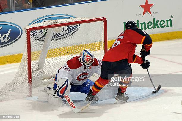 Aleksander Barkov of the Florida Panthers shoots and scores his second goal of the game during the third period against the Montreal Canadiens at the...