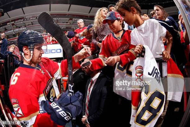 Aleksander Barkov of the Florida Panthers signs a few autographs while heading to the dressing room after warm ups prior to the start of the game...