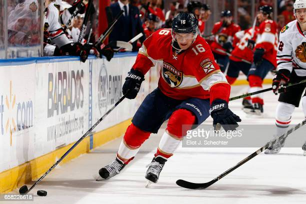 Aleksander Barkov of the Florida Panthers skates along the boards with the puck against the Chicago Blackhawks at the BBT Center on March 25 2017 in...