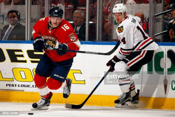 Aleksander Barkov of the Florida Panthers skates for the puck against Richard Panik of the Chicago Blackhawks at the BBT Center on March 25 2017 in...
