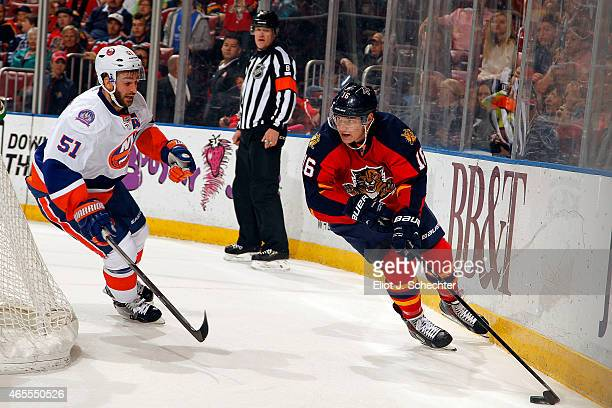 Aleksander Barkov of the Florida Panthers skates with the puck against Frans Nielsen of the New York Islanders at the BBT Center on March 7 2015 in...