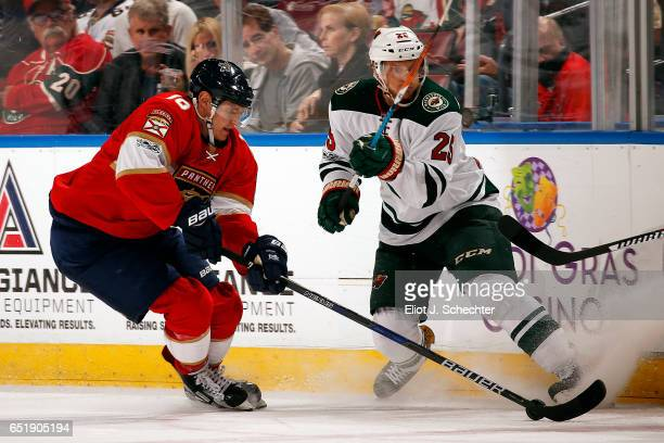Aleksander Barkov of the Florida Panthers skates with the puck against Jonas Brodin of the Minnesota Wild at the BBT Center on March 10 2017 in...