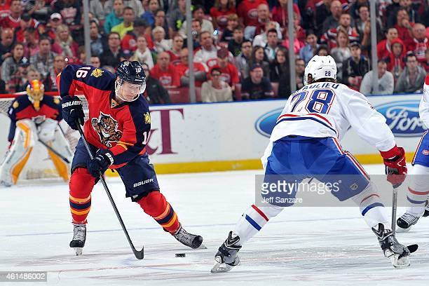 Aleksander Barkov of the Florida Panthers skates with the puck against Nathan Beaulieu of the Montreal Canadiens at the BBT Center on December 30...