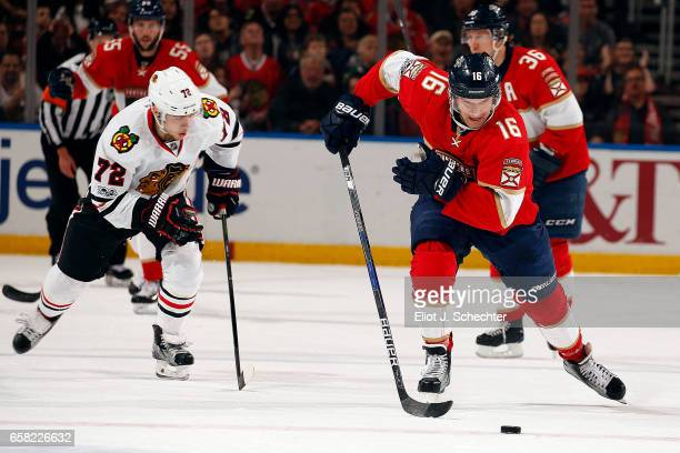 Aleksander Barkov of the Florida Panthers skates with the puck against Artemi Panarin of the Chicago Blackhawks at the BBT Center on March 25 2017 in...