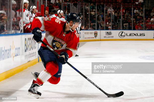 Aleksander Barkov of the Florida Panthers skates with the puck against the Carolina Hurricanes at the BBT Center on March 21 2017 in Sunrise Florida