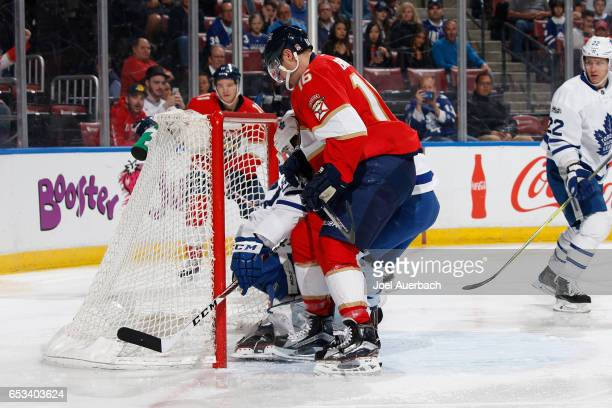 Aleksander Barkov of the Florida Panthers slips the puck between the post and goaltender Frederik Andersen of the Toronto Maple Leafs to score a goal...