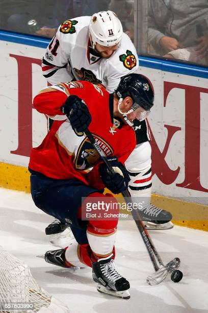 Aleksander Barkov of the Florida Panthers tangles with Andrew Desjardins of the Chicago Blackhawks at the BBT Center on March 25 2017 in Sunrise...