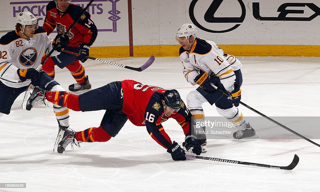 <a gi-track='captionPersonalityLinkClicked' href=/galleries/search?phrase=Aleksander+Barkov&family=editorial&specificpeople=8760147 ng-click='$event.stopPropagation()'>Aleksander Barkov</a> #16 of the Florida Panthers tangles with <a gi-track='captionPersonalityLinkClicked' href=/galleries/search?phrase=Marcus+Foligno&family=editorial&specificpeople=5662790 ng-click='$event.stopPropagation()'>Marcus Foligno</a> #82 and <a gi-track='captionPersonalityLinkClicked' href=/galleries/search?phrase=Christian+Ehrhoff&family=editorial&specificpeople=214788 ng-click='$event.stopPropagation()'>Christian Ehrhoff</a> #10 of the Buffalo Sabres at the BB&T Center on October 25, 2013 in Sunrise, Florida.