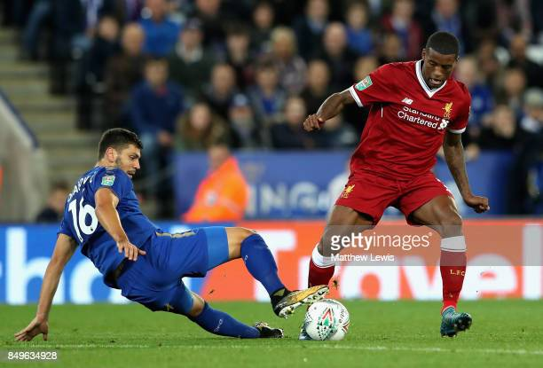 Aleksander Dragovic of Leicester City tackles Georginio Wijnaldum of Liverpool during the Carabao Cup Third Round match between Leicester City and...