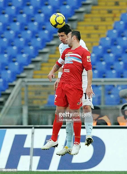 Aleksander Kolarov of Lazio and Giuseppe Mascara of Catania in action during the Serie A match between Lazio and Catania at Stadio Olimpico on...