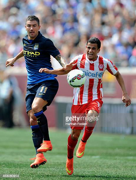 Aleksander Kolarov of Manchester City and Omar Elabdellaoui of Olympiacos chase after the ball during the first half of the International Champions...