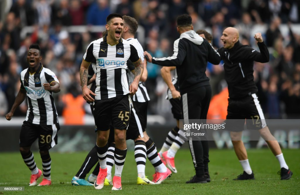 Aleksander Mitrovic and team mates of Newcastle celebrate after hearing the score from the Brighton game means that they win the the Sky Bet Championship title after the match between Newcastle United and Barnsley at St James' Park on May 7, 2017 in Newcastle upon Tyne, England.