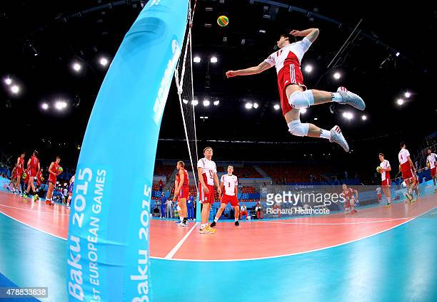 Aleksander Sliwka of Poland smashes during the warm up ahead of the Men's Volleyball bronze medal match between Poland and Russia on day sixteen of...