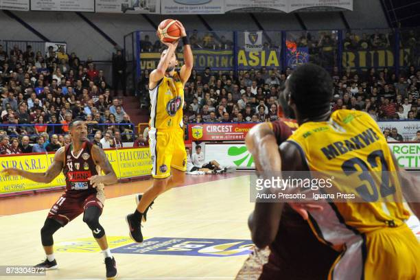 Aleksander Vujacic and Trevor Mbakwe of Fiat competes with Michael Jenkins and Mitchell Watt of Umana during the LBA LegaBasket of Serie A match...
