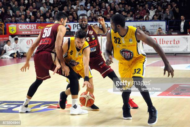 Aleksander Vujacic and Trevor Mbakwe of Fiat competes with Mitchell Watt and Dominique Johnson of Umana during the LBA LegaBasket of Serie A match...