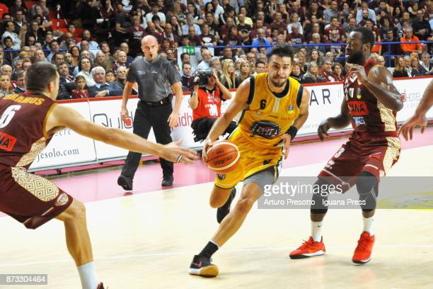 Aleksander Vujacic of Fiat competes with Michael Bramos and Dominique Johnson of Umana during the LBA LegaBasket of Serie A match between Reyer Umana...