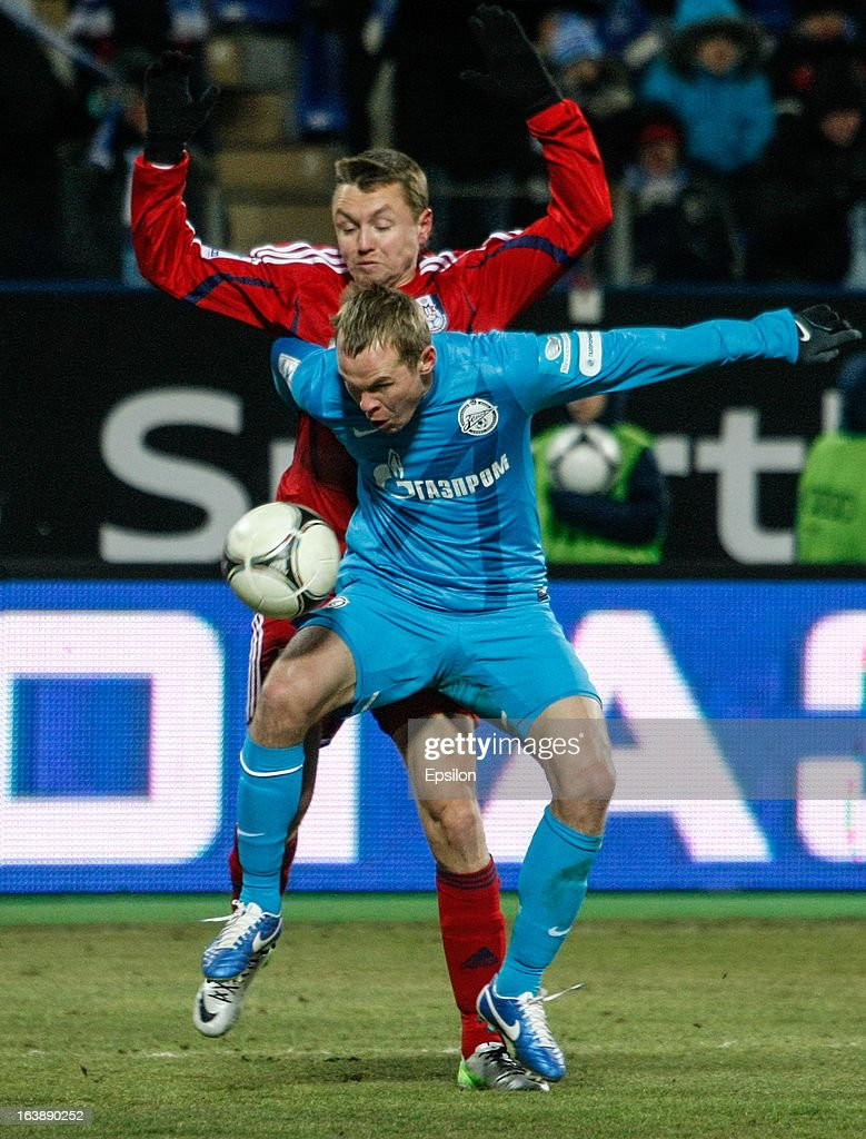 Aleksandr Anyukov of FC Zenit St. Petersburg (in front) vies for the ball with Anton Bober of FC Mordovia Saransk during the Russian Football League Championship match between FC Zenit St. Petersburg and FC Mordovia Saransk at the Petrovsky Stadium on March 17, 2013 in St. Petersburg, Russia.