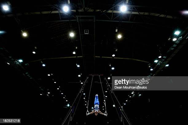 Aleksandr Balandin of Russia competes in the Rings Qualifying on Day One of the Artistic Gymnastics World Championships Belgium 2013 held at the...