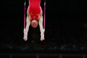 Aleksandr Balandin of Russia competes on the Artistic Gymnastics Men's Rings on Day 10 of the London 2012 Olympic Games at North Greenwich Arena on...