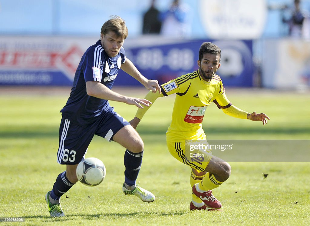 Aleksandr Belozyorov (L) of FC Volga Nizhny Novgorod battles for the ball with <a gi-track='captionPersonalityLinkClicked' href=/galleries/search?phrase=Mehdi+Carcela-Gonzalez&family=editorial&specificpeople=6539324 ng-click='$event.stopPropagation()'>Mehdi Carcela-Gonzalez</a> of FC Anzhi Makhachkala during the Russian Premier League match between FC Volga Nizhny Novgorod and FC Anzhi Makhachkala at Lokomotiv Stadium on April 14, 2013 in Nizhny Novgorod, Russia.