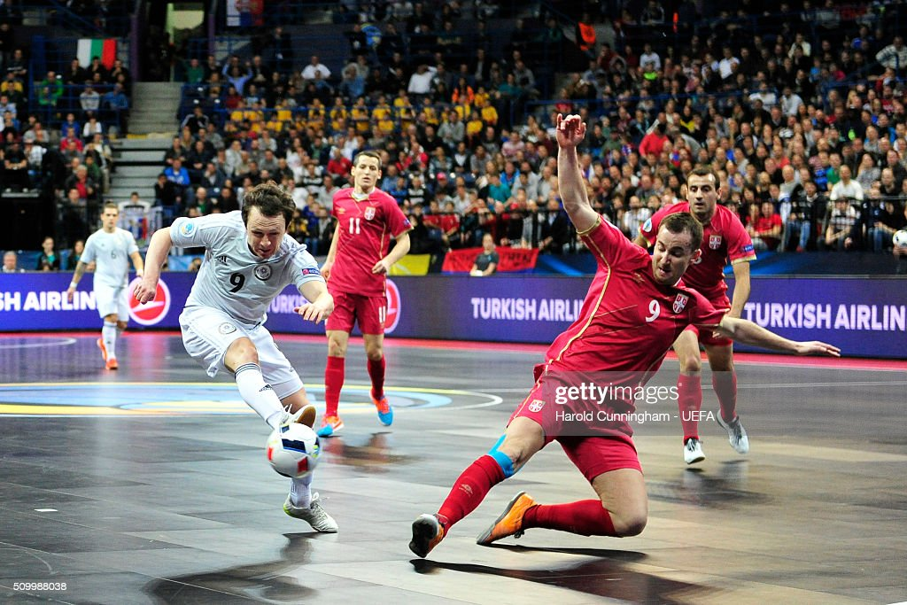 Aleksandr Dovgan of Kazakhstan and Vladimir Lazic of Serbia in action during the UEFA Futsal EURO 2016 third place play off match between Serbia and Kazakhstan at Arena Belgrade on February 13, 2016 in Belgrade, Serbia.