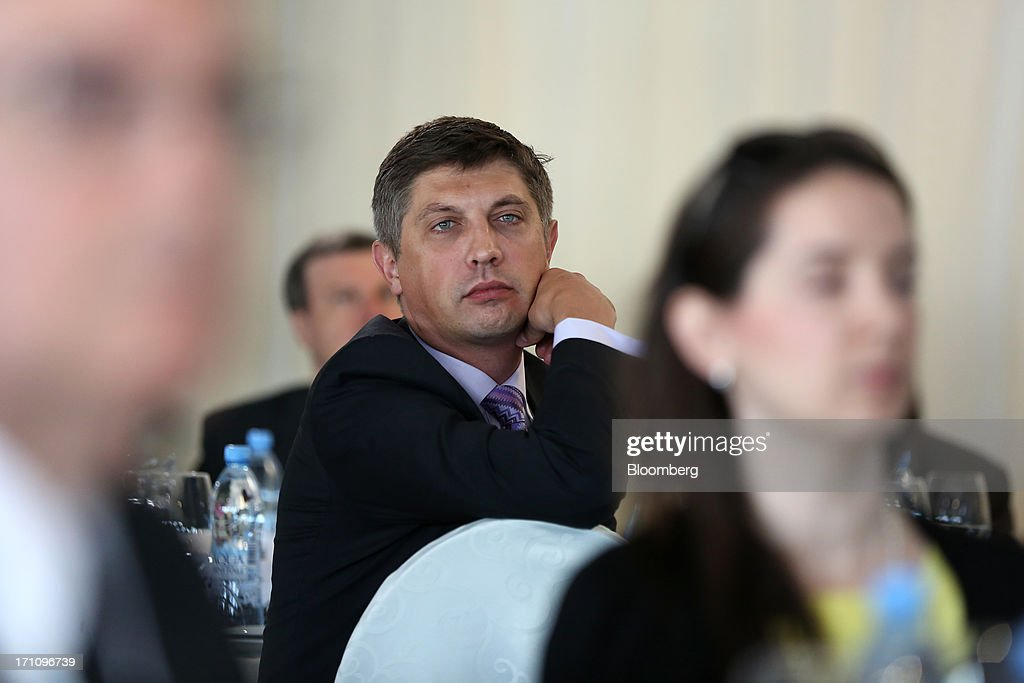 Aleksandr Egorov, chief executive officer of Reksoft, listens to speakers during a morning session on the closing day of the St. Petersburg International Economic Forum (SPIEF) in St. Petersburg, Russia, on Saturday, June 22, 2013. President Vladimir Putin unveiled a plan to jolt Russia's economy out of the worst growth in four years, promising to help the central bank cut inflation and pledging about $14 billion of savings to revamp roads and railways. Photographer: Andrey Rudakov/Bloomberg via Getty Images