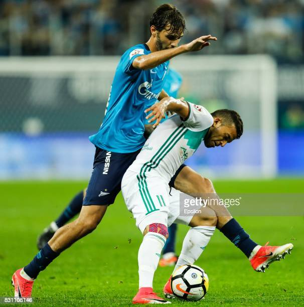 Aleksandr Erokhin of FC Zenit Saint Petersburg and Ismael Silva of FC Akhmat Grozny vie for the ball during the Russian Football League match between...