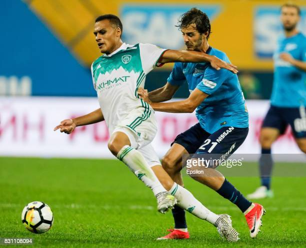 Aleksandr Erokhin of FC Zenit Saint Petersburg and Leo Jaba of FC Akhmat Grozny vie for the ball during the Russian Football League match between FC...