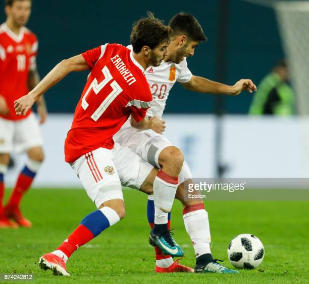 Aleksandr Erokhin of Russia and Marco Asensio of Spain vie for the ball during Russia and Spain International friendly match on November 14 2017 at...