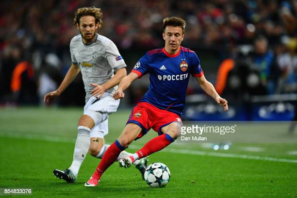 Aleksandr Golovin of CSKA Moscow and Daley Blind of Manchester United in action during the UEFA Champions League group A match between CSKA Moskva...