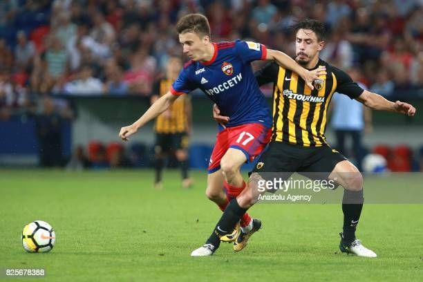 Aleksandr Golovin of CSKA Moscow in action against Andre Simoes of AEK Athens during the UEFA Champions League 3rd Qualifying Round match between...