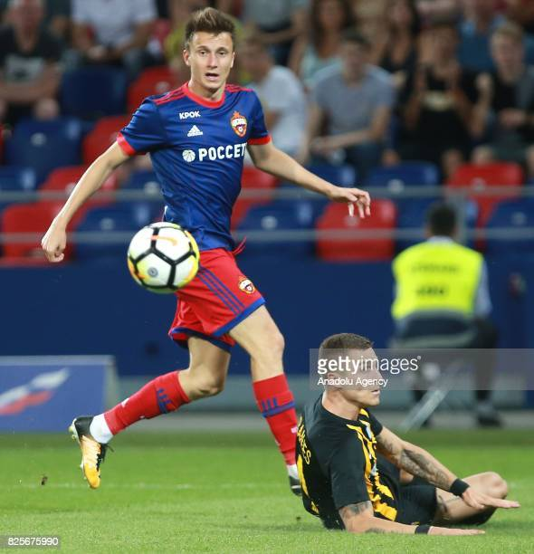 Aleksandr Golovin of CSKA Moscow in action against Ognjen Vranjes of AEK Athens during the UEFA Champions League 3rd Qualifying Round match between...