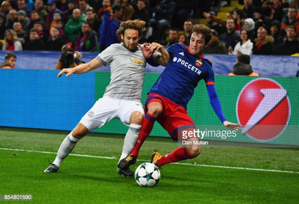 Aleksandr Golovin of CSKA Moscow tackles Daley Blind of Manchester United during the UEFA Champions League group A match between CSKA Moskva and...