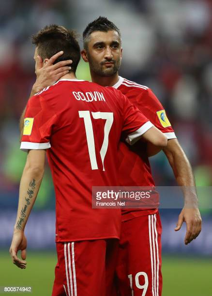 Aleksandr Golovin of Russia and Alexander Samedov of Russia embrace after the FIFA Confederations Cup Russia 2017 Group A match between Mexico and...