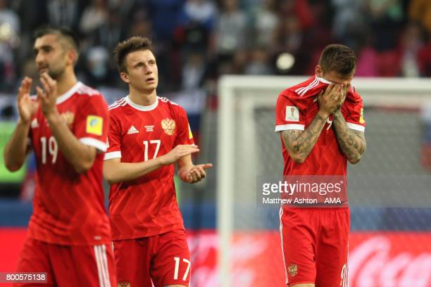 Aleksandr Golovin of Russia and Fedor Smolov look dejected at the end of the FIFA Confederations Cup Russia 2017 Group A match between Mexico and...