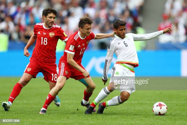 Aleksandr Golovin of Russia and Jonathan Dos Santos of Mexico battle for possession during the FIFA Confederations Cup Russia 2017 Group A match...