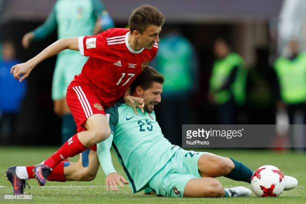 Aleksandr Golovin of Russia national team and Adrien Silva of Portugal national team vie for the ball during the Group A FIFA Confederations Cup...